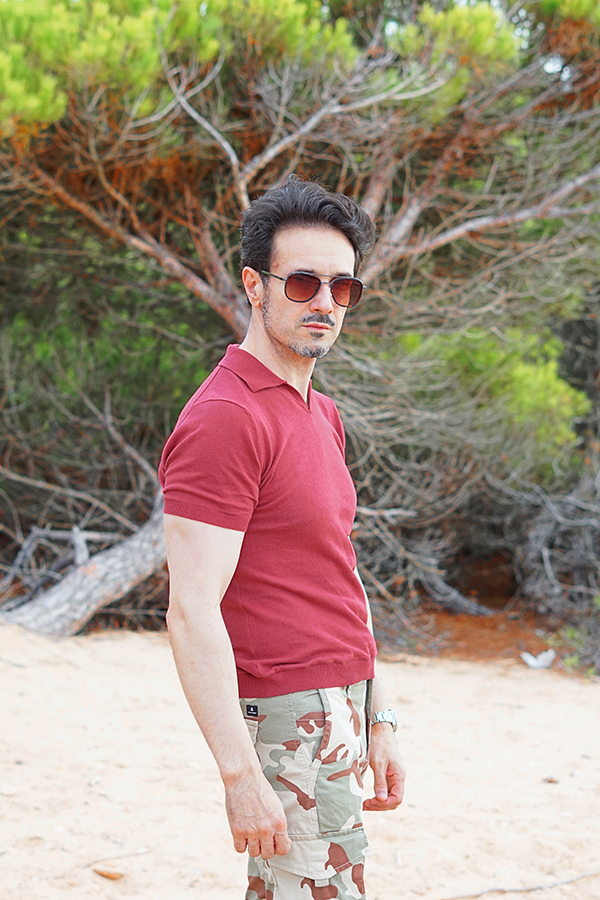 man with red polo shirt